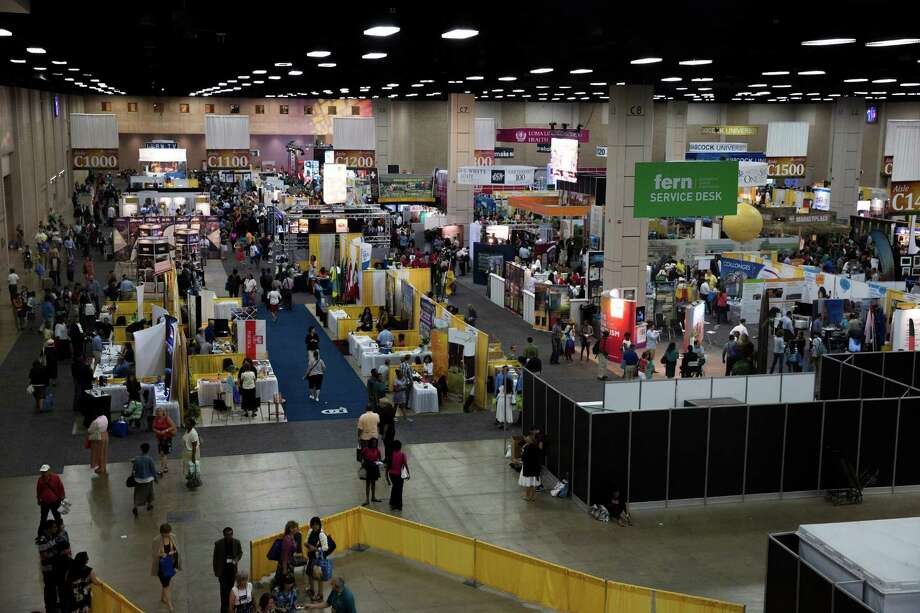 Attendees of the 60th General Conference Session of the Seventh-day Adventist Church walk through Hall C of the Henry B. Gonzalez Convention Center. The convention was San Antonio's largest ever, bringing about 65,000 churchgoers from around the world. Photo: Ray Whitehouse /San Antonio Express-News / 2015 San Antonio Express-News