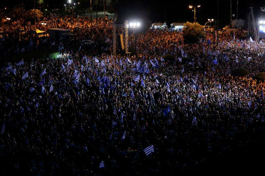"""Demonstrators gather in Athens during a Friday rally organized by supporters of the """"yes"""" vote. Sunday's referendum will be on whether Greeks will accept more austerity in return for bailout loans. Rallies for both campaigns were also held in 10 other cities in Greece. Photo: Emilio Morenatti, STF / AP"""