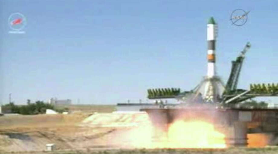 In this image taken from video, a Soyuz-U rocket blasts off at the Russian leased Baikonur cosmodrome, Kazakhstan, Friday, July 3, 2015. The unmanned cargo ship is heading to the International Space Station, whose crew is anxiously awaiting it after the successive failures of two previous supply missions. (NASA TV via AP) Photo: HOGP / NASA TV