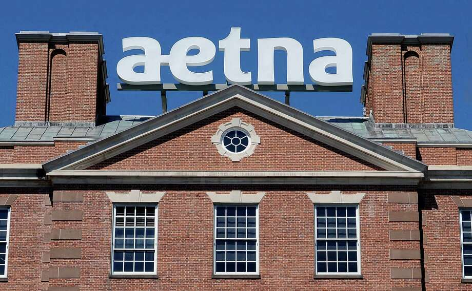 FILE  - In this Tuesday, Aug. 19, 2014, file photo, a sign for Aetna Inc., sits atop a building at the company headquarters in in Hartford, Conn. Health insurer Aetna Inc. has made a deal to buy competitor Humana Inc. in a $37 billion deal the companies say would create the second-largest managed care company, it was announced Friday, July 3, 2014. (AP Photo/Jessica Hill, File) Photo: Jessica Hill, FRE / FR125654 AP