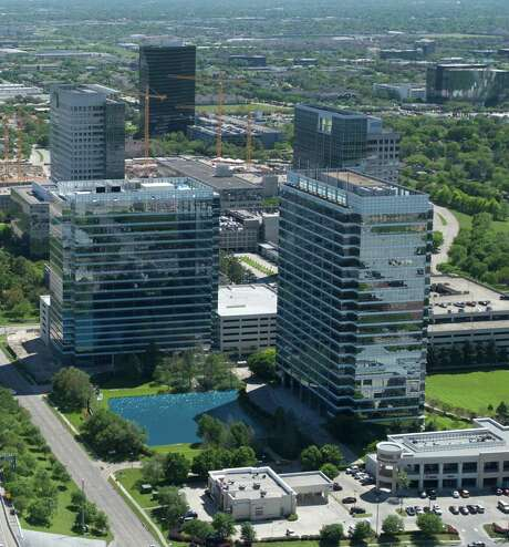 Two BriarLake Plaza, left, was recently completed next to One BriarLake Plaza in the Westchase District.  Photo: Rehak Creative Services, Westchase Aerials  2014 / © 2014 Rehak Creative Services