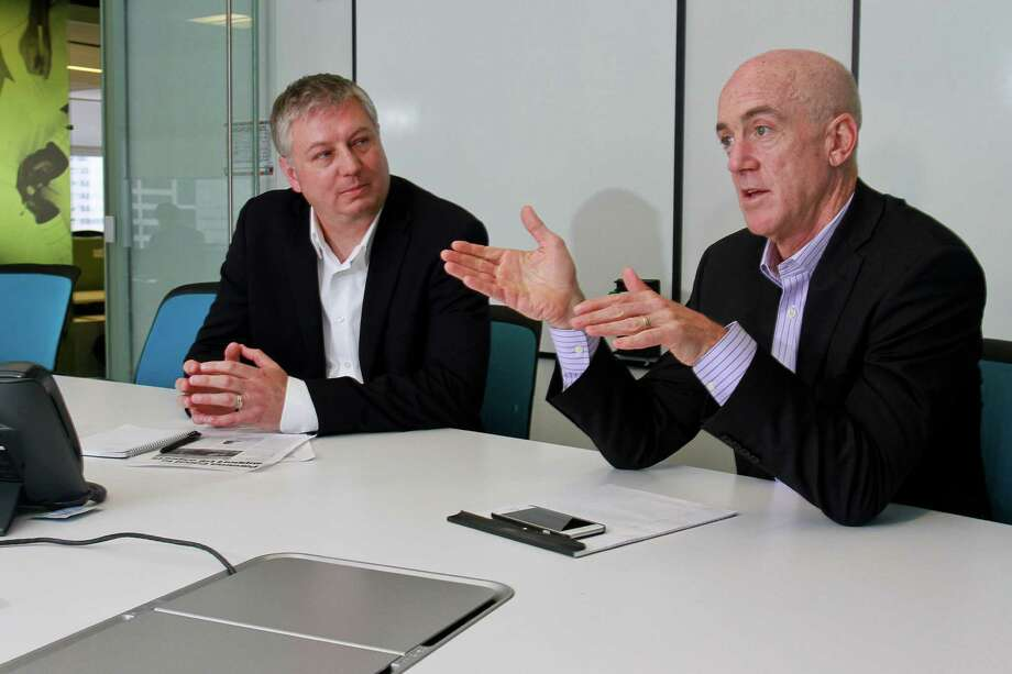 Paul Bjacek, left, and John Poisson of Accenture, discuss how the Panama Canal expansion next year is expected to benefit the petrochemical industry and the Port of Houston.  (For the Chronicle/Gary Fountain, April 9, 2015) Photo: Gary Fountain, Freelance / Copyright 2015 by Gary Fountain