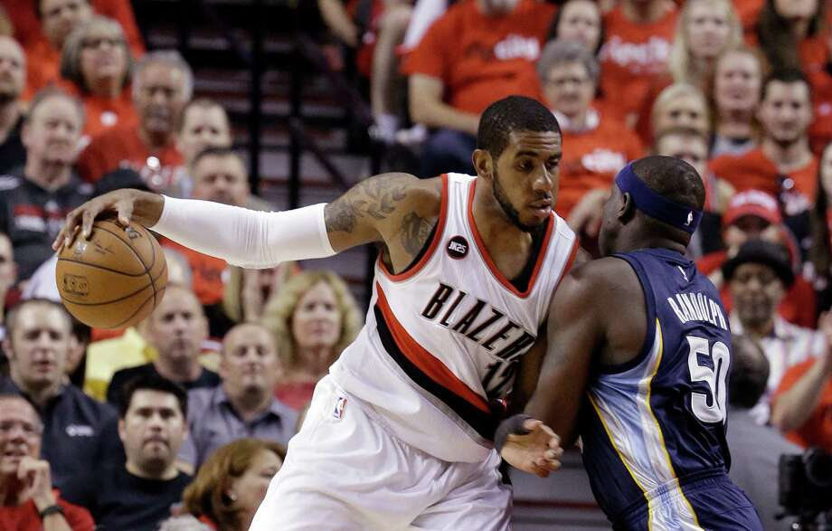 FILE - In this Monday, April 27, 2015 file photo, Portland Trail Blazers forward LaMarcus Aldridge, left, works the ball in against Memphis Grizzlies forward Zach Randolph during the first half of Game 4 of a first-round NBA basketball playoff series in Portland, Ore. A person with knowledge of the negotiations says LaMarcus Aldridge and the Miami Heat have spoken about his future plans, and that a formal conversation is scheduled for Thursday night, July 2, 2015.  (AP Photo/Don Ryan, File) Photo: Don Ryan, STF / Associated Press / AP