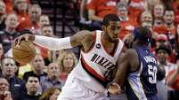 Portland Trail Blazers forward LaMarcus Aldridge works the ball in against Memphis Grizzlies forward Zach Randolph during the first half of Game 4 of a first-round NBA playoff series in Portland, Ore., on April 27, 2015.