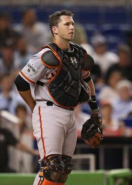 MIAMI, FL - JULY 01: Buster Posey #28 of the San Francisco Giants looks on before being taken out of the game against the Miami Marlins at Marlins Park on July 1, 2015 in Miami, Florida.  (Photo by Rob Foldy/Getty Images)