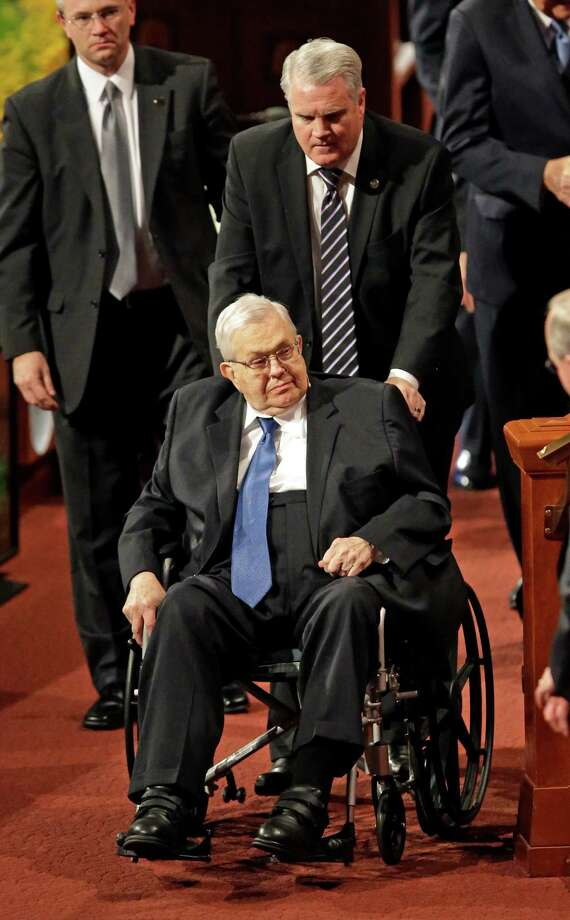 FILE - This April 4, 2015, file photo, shows President Boyd K. Packer, seated, of the Quorum of the Twelve Apostles, of The Church of Jesus Christ of Latter-day Saints, leaving the opening session of the Mormon church conference, in Salt Lake City. Mormon leader Packer, president of the faith's highest governing body, has died. He was 90. Church spokesman Eric Hawkins said Packer died Friday, July 3, 2015, at his home in Salt Lake City from natural causes. (AP Photo/Rick Bowmer, File) Photo: Rick Bowmer, STF / AP