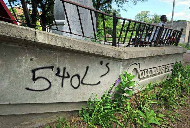 The Columbus memorial erected for the 500th anniversary of the trip to America, is defaced with gang markings, at King and Jacob Streets on Thursday, July 2, 2015, in Troy, N.Y.  (Michael P. Farrell/Times Union) Photo: Michael P. Farrell / 00032473A