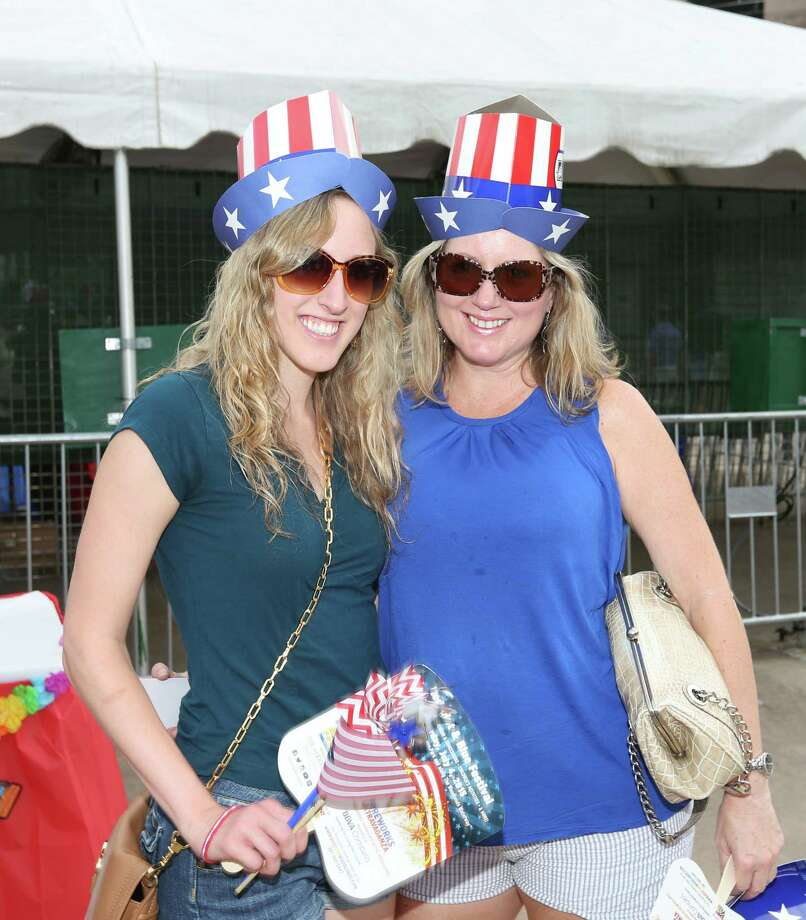 Fans pose for a photo before the Star-Spangled Salute at the Cynthia Woods Mitchell Pavilion Friday, July 3, 2015, in The Woodlands. Photo: Jon Shapley, Houston Chronicle / © 2015 Houston Chronicle