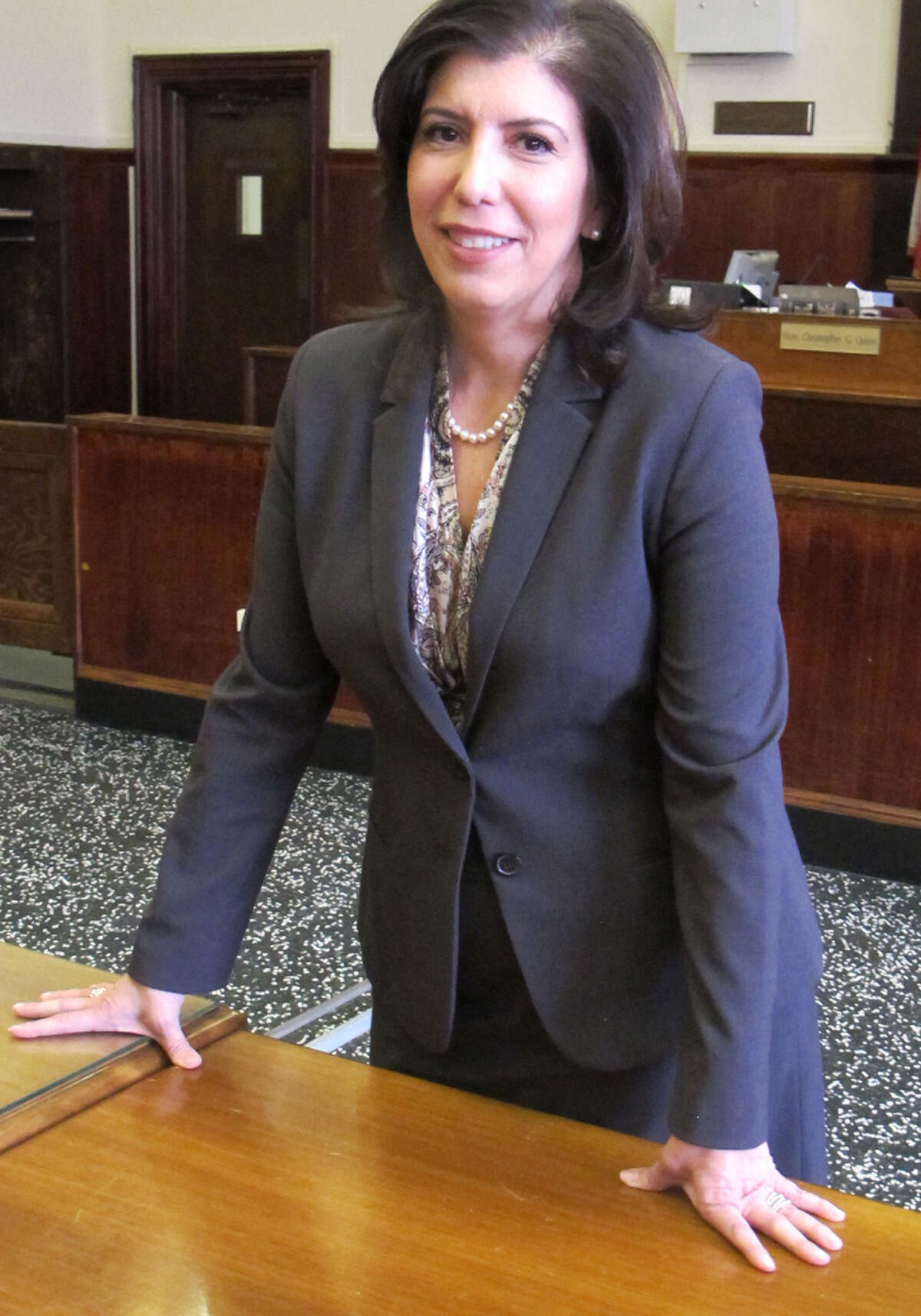 """FILE- In this June 6, 2015 file photo, Madeline Singas poses in a Mineola, N.Y., courtroom moments after being sworn in as the acting district attorney for Nassau County. Singas said compliance with a state law requiring schools to report incidents of bullying, harassment or intimidation is a """"disaster,"""" after finding that 58 percent of all schools statewide failed to report even one incident, and 82 percent found no incidents of cyberbullying. (AP Photo/Frank Eltman, File) ORG XMIT: NYR101"""