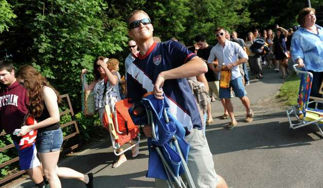 Tyler Kissinger of Poughkeepsie, center, gets ready to pass through security for the Dave Matthews Band show on Friday, July 3, 2015, at Saratoga Performing Arts Center in Saratoga Springs, N.Y. (Cindy Schultz / Times Union) Photo: Cindy Schultz / 00032321A