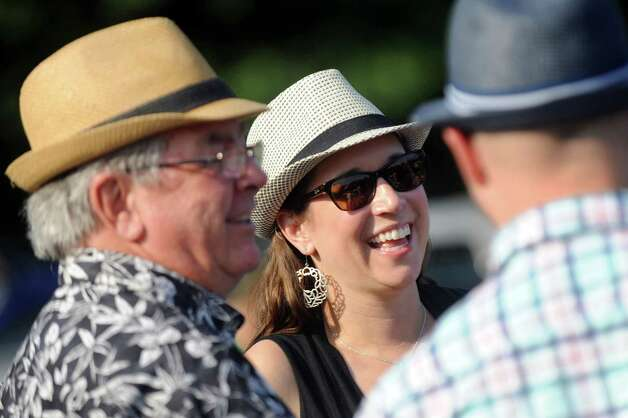 Robin Roger McKenzie of Ithaca, center, tailgates with her father-in-law, Donald McKenzie, left, and husband, Charles McKenzie before the Dave Matthews Band show on Friday, July 3, 2015, at Saratoga Performing Arts Center in Saratoga Springs, N.Y. (Cindy Schultz / Times Union) Photo: Cindy Schultz / 00032321A