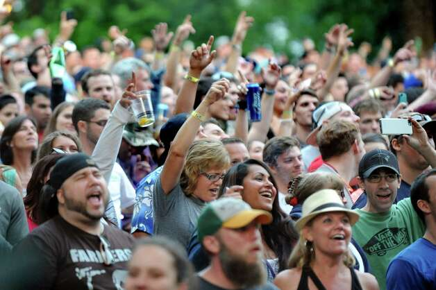 Music fans jam along with the Dave Matthews Band on Friday, July 3, 2015, at Saratoga Performing Arts Center in Saratoga Springs, N.Y. (Cindy Schultz / Times Union) Photo: Cindy Schultz / 00032321A
