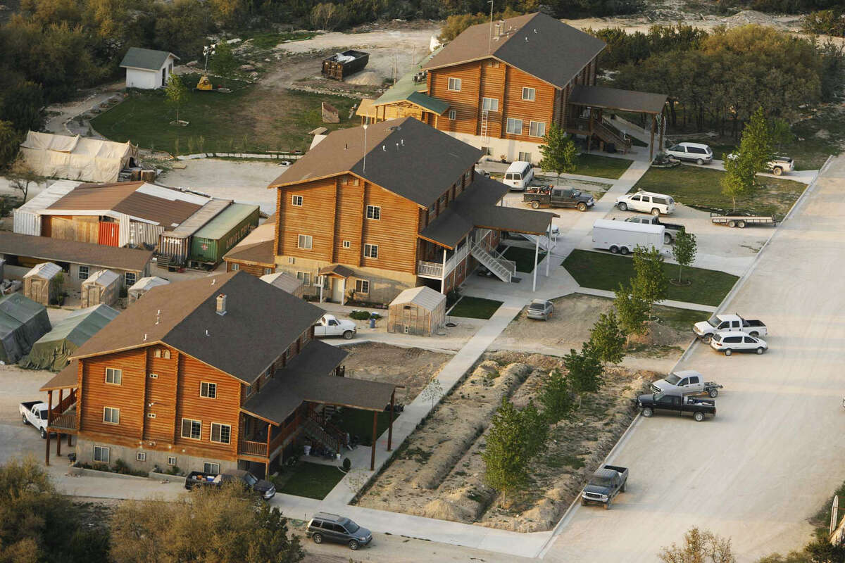 This Tuesday, April 8, 2008 photo shows an aerial view of the Fundamentalist Church of Jesus Christ of Latter Day Saints compound Yearning for Zion Ranch, in Eldorado, Texas. Seven years after a massive police raid on the polygamous group's ranch, Schleicher County Sheriff David Doran is tasked with making sure the property stays intact, including the gleaming white temple built by the Utah-based group led by Warren Jeffs, as the state tries to sell the expansive property. (Trent Nelson/The Salt Lake Tribune via AP)