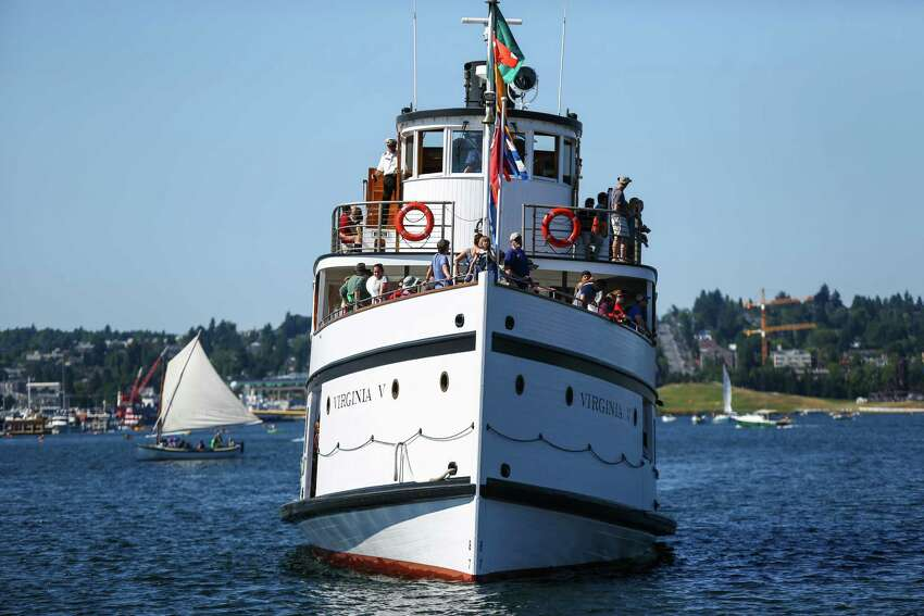 The historic Virginia V cruises on the lake during the 39th annual Lake Union Wooden Boat Festival. The free annual event celebrates the maritime heritage of the Northwest, offering tours, music and rides on the water in historic wooden boats. The festival continues through July 5th at Lake Union Park and the Center for Wooden Boats.