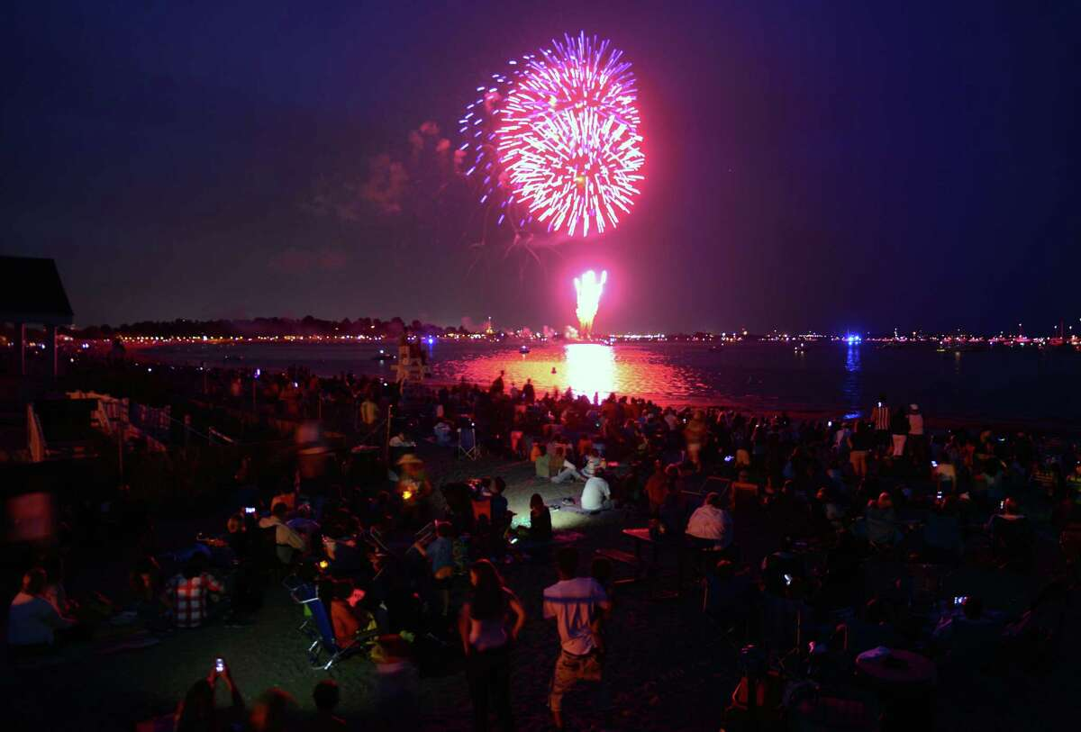 Hundreds of spectators watch the holiday fireworks display at Penfield and Jennings Beaches in Fairfield, Conn., on Friday July 3, 2015.