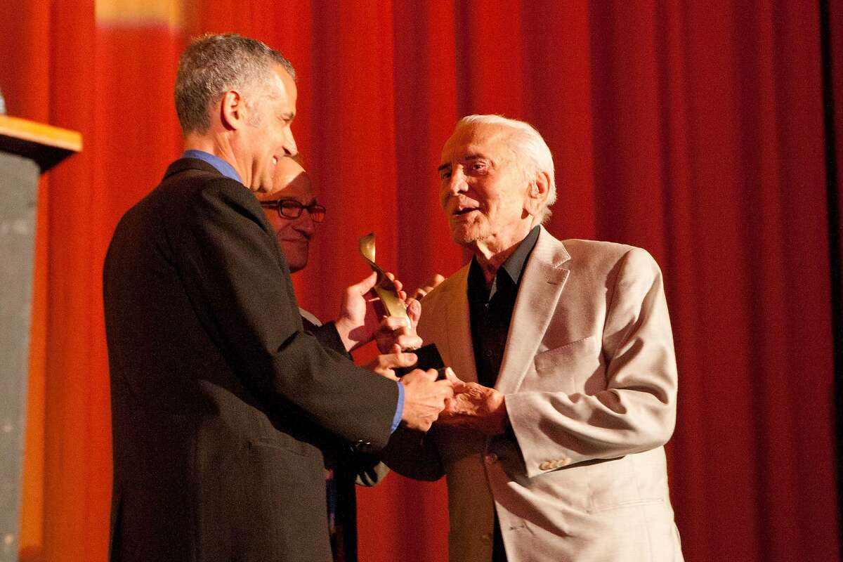 In 2011, Kirk Douglas receives the Freedom of Expression award from the festival's Jay Rosenblatt (l) and Peter L. Stein Photo by Drew Altizer