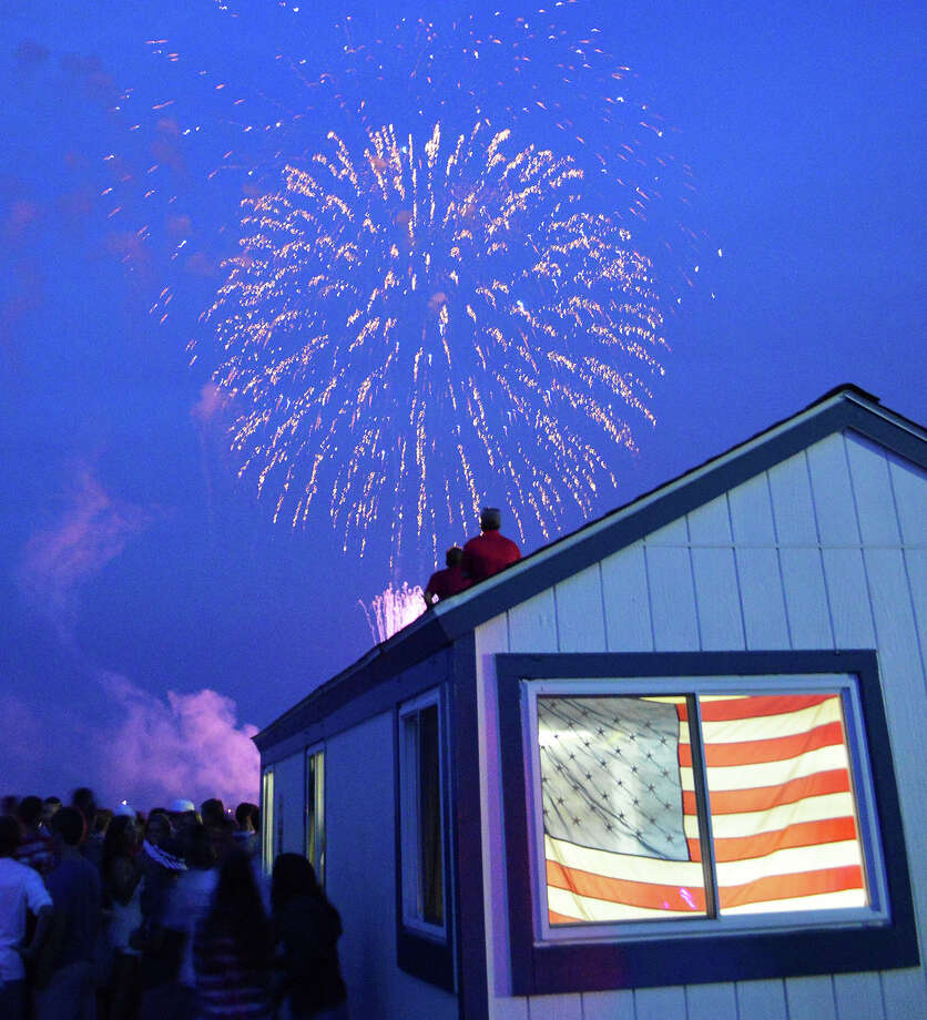 Bombs burst in the warm evening air over Compo Beach on Friday evening, as thousands turned out for the town's annual Independence Day fireworks show. Photo: Jarret Liotta / For Hearst Connecticut Media / Westport News