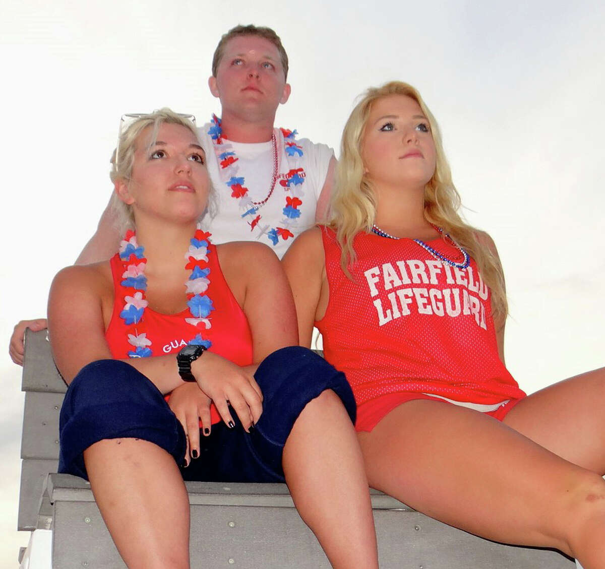 Lifeguards Harley French, her sister Rebecca and Eric Rasmussen keep watch over the crowds at the fireworks show in Fairfield.
