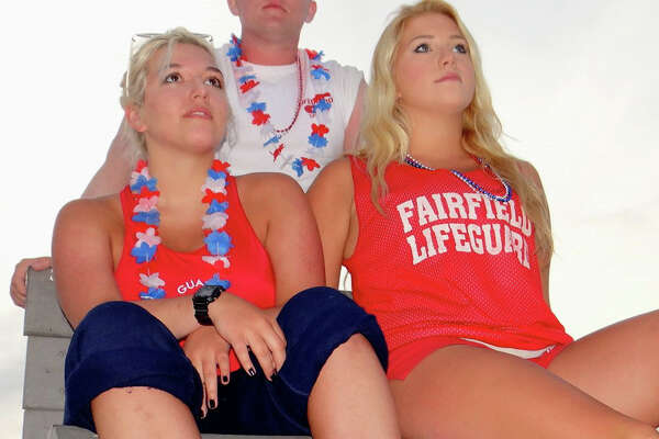 Lifeguards Harley French, her sister Rebecca and Eric Rasmussen keep watch over the crowds Friday night at the fireworks show.