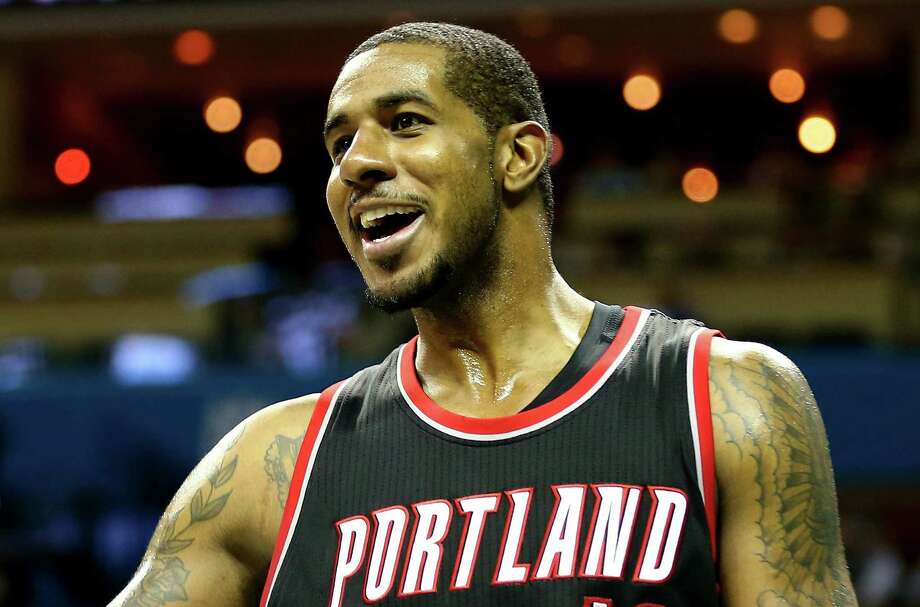 FILE - JULY 4:  Free-agent LaMarcus Aldridge has agreed to sign a four-year, $80 million contract with the San Antonio Spurs, July 4, 2015. CHARLOTTE, NC - NOVEMBER 26:  LaMarcus Aldridge #12 of the Portland Trail Blazers reacts after a play during their game against the Charlotte Hornets at Time Warner Cable Arena on November 26, 2014 in Charlotte, North Carolina.  NOTE TO USER: User expressly acknowledges and agrees that, by downloading and or using this photograph, User is consenting to the terms and conditions of the Getty Images License Agreement.  (Photo by Streeter Lecka/Getty Images) Photo: Streeter Lecka, Staff / 2014 Getty Images