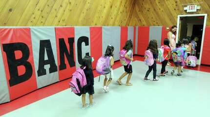 A New Lebanon School kindergarten class exits the BANC building gym on the first day of school for the Greenwich public schools on Aug. 26, 2014. Due to overcrowding issues, the New Lebanon School kindergarten classes were moved to the Byram Archibald Neighborhood Center at 289 Delavan Ave., in the downtown Byram section of Greenwich.