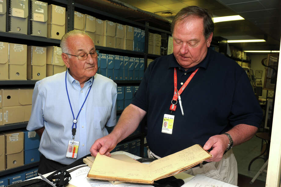 Dan Libertino, left, and John Bulakowski, President and Vice President respectively, look through materials in the Igor I. Sikorsky Historical Archives in 2014. The two were guest speakers at the Greenwich Retired Men's Association recently. Photo: Ned Gerard / Ned Gerard / Connecticut Post