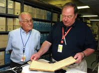 Dan Libertino, left, and John Bulakowski, President and Vice President respectively, look through materials in the Igor I. Sikorsky Historical Archives in 2014. The two were guest speakers at the Greenwich Retired Men's Association recently.