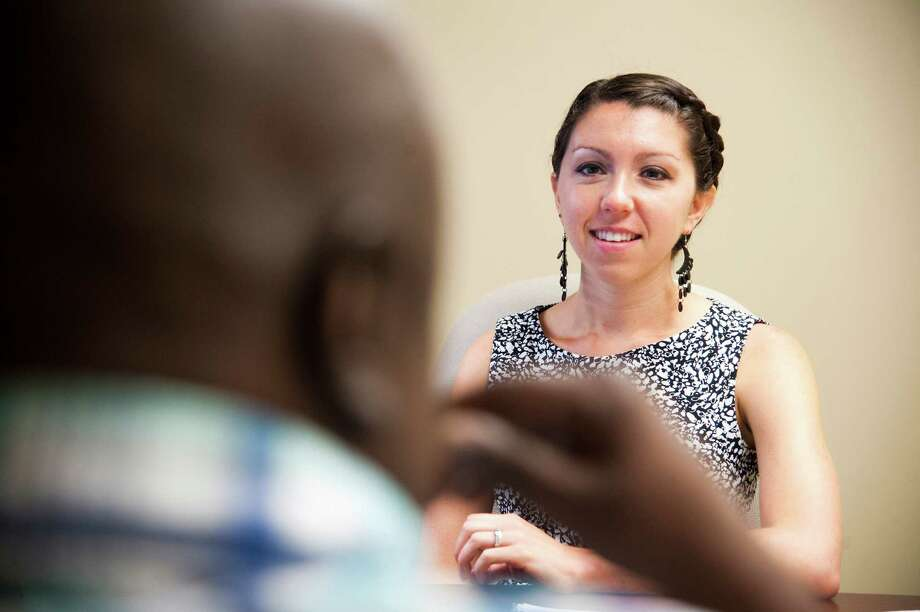 Cancer care navigator Elizabeth Glidden talks with Anthony Washington, who was diagnosed with lung cancer 15 months ago, in her office in Washington. Patient navigators help patients with everything from medical options to transportation because doctors no longer have time to do so.  Illustrates CANCER (category a), by Lenny Bernstein (c) 2015, The Washington Post. Moved Friday, July 3, 2015. (MUST CREDIT: Washington Post photo by Katherine Frey) Photo: Katherine Frey, STF / The Washington Post