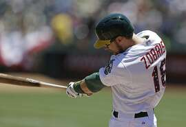 Oakland Athletics' Ben Zobrist swings for an RBI-single off Seattle Mariners' Felix Hernandez in the first inning of a baseball game Saturday, July 4, 2015, in Oakland, Calif. (AP Photo/Ben Margot)
