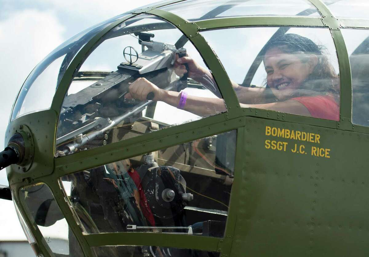 Dr. Ani Tejada sits in the nose of the B-25 bomber