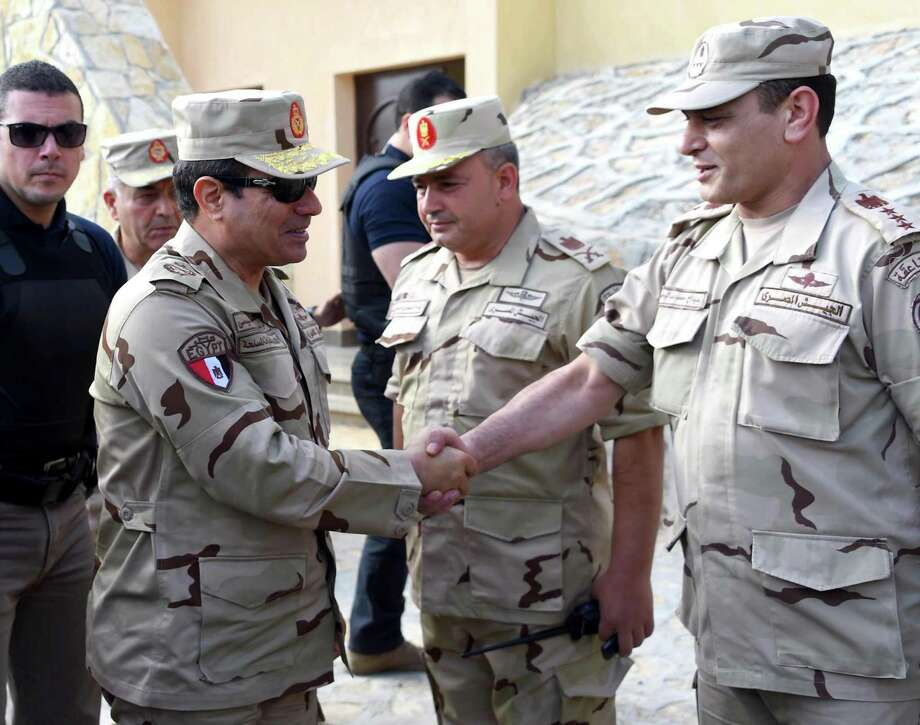 Egyptian President Abdel-Fattah el-Sissi, second left, greets members of the Egyptian armed forces Saturday in the northern Sinai. Photo: Mohammed Abdel-Muati, HOGP / Egyptian Presidency