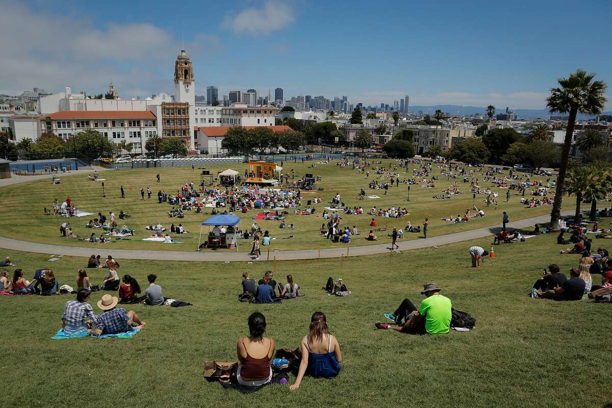 An audience begins to form in anticipation of The San Francisco Mime Troupe's annual Fourth of July performance at Mission Dolores Park in San Francisco, California, on Saturday, July 4, 2015. The show was free to watch for park-goers.