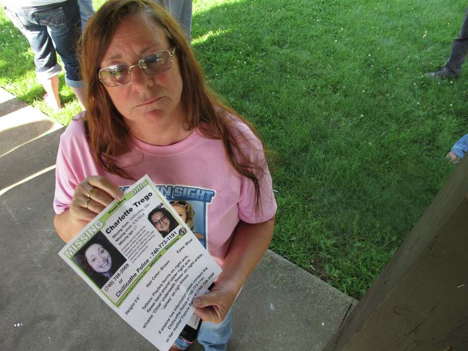 Yvonne Boggs holds a flier seeking information on her daughter, Charlotte Trego, who has been missing for more than a year, in Chillicothe, Ohio. Photo: Andrew Welsh-Huggins /Associated Press / AP