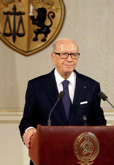 """Tunisian President Beji Caid Essebsi, speaks as he announces the state emergency in Tunis, Tunisia, Saturday July 4, 2015.Tunisia's president declared a state of emergency on Saturday in response to a second deadly attack on foreigners in three months, saying the country is """"not safe"""" and risks collapse from further extremist attacks. (AP Photo/Ali Louati) Photo: Ali Louati, STR / AP"""