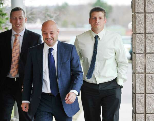 Joshua Rockwood, right, walks back into Glenville Town Court with his lawyer on Monday, April 27, 2015, in Glenville, N.Y.  Rockwood, who had his horses seized for alleged neglect, was at court for a hearing on the case.   (Paul Buckowski / Times Union) Photo: PAUL BUCKOWSKI / 00031610A