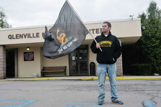 Matt Sweet of Gloversville, and a member of Fulton County chapter of Oathkeepers, stands outside of Glenville Town Court on Monday, April 27, 2015, in Glenville, N.Y.  Sweet, along with other members of Oathkeepers, came to court to support farmer Joshua Rockwood who had his horses seized for alleged neglect.  (Paul Buckowski / Times Union) Photo: PAUL BUCKOWSKI / 00031610A