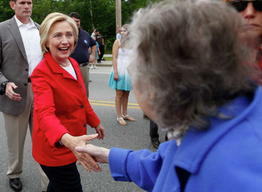 Democratic presidential candidate Hillary Clinton greets a spectator at a Fourth of July parade in Gorham, N.H. During a campaign event, she spoke about issues including college affordability. Photo: Robert F. Bukaty /Associated Press / AP