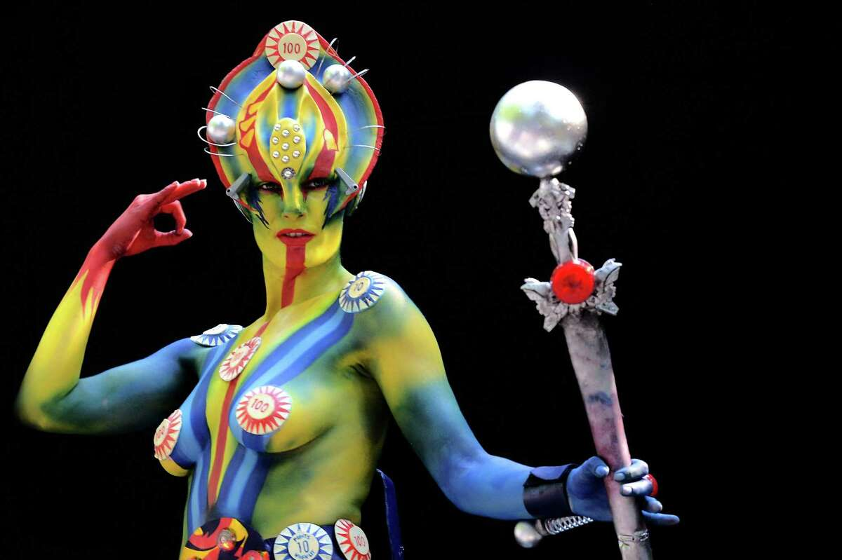 A participant poses with her body paintings designed by bodypainting artist Samantha Fernandez, from New Zealand, in the 2015 World Bodypainting Festival on July 3, 2015, in Poertschach am Woerthersee, Austria. The 18th edition of the festival sees more than 45 nations compete in the modern bodypainting art movement.