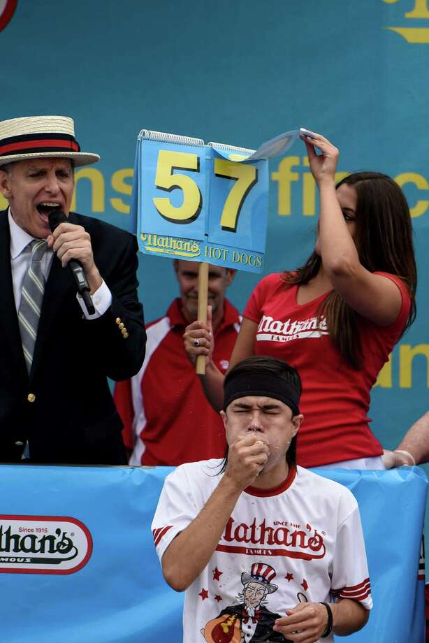 NEW YORK, NY - JULY 4: Mike Stonie on his 57th hot dog at The Nathan's Famous Fourth of July International Hot Dog-Eating Contest in Coney Island, New York, on July 4, 2015. The contest is an annual Fourth of July tradition. (Photo by Andrew Renneisen/Getty Images) Photo: Andrew Renneisen, Stringer / Getty Images / 2015 Getty Images