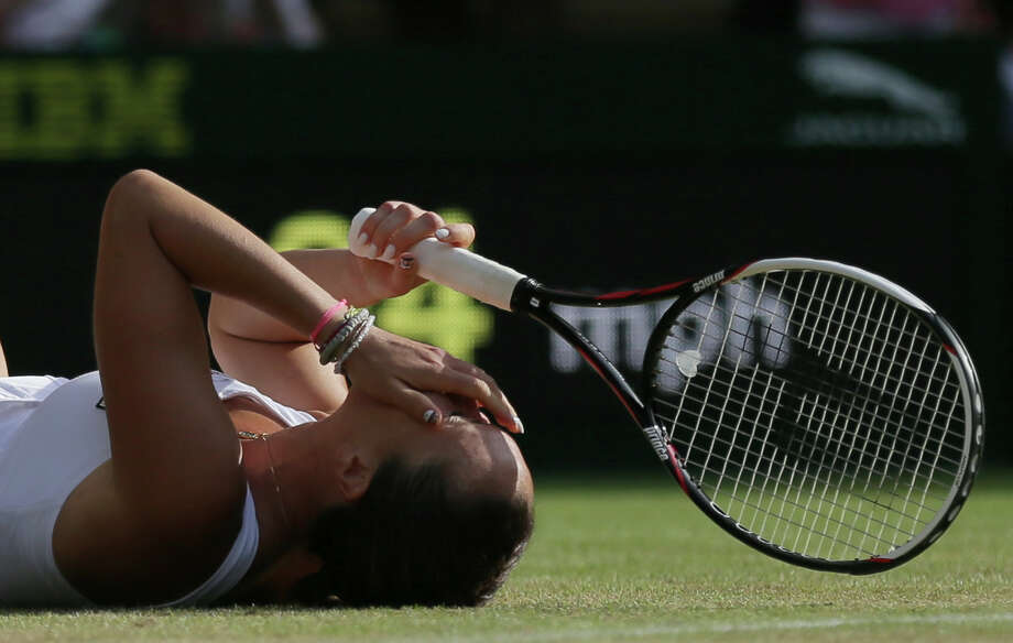 """Never one to excel at Wimbledon, Jelena Jankovic found it """"unbelievable"""" that she was able to upend defending champion Petra Kvitova on Saturday. Photo: Tim Ireland, STR / AP"""