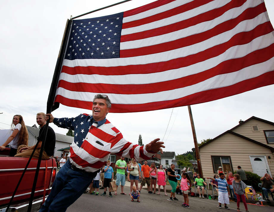 Johnny Garcia, of Veneta, Ore., waves to the crowd as he joins members of his family in the 2015 Creswell Fourth of July Parade in Creswell, Ore. July 4, 2015. (Chris Pietsch/The Register-Guard via AP Photo) Photo: Chris Pietsch, MBO / The Register-Guard