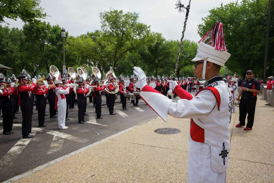 Waltrip High School Drum Major Kevin Woodard warms up the band prior to the parade as Director of Bands Jesse Espinoza looks on during the National Independence Day Parade on Saturday, July 4, 2015, in Washington, DC.  Photo: David Scarbrough / David Scarbrough