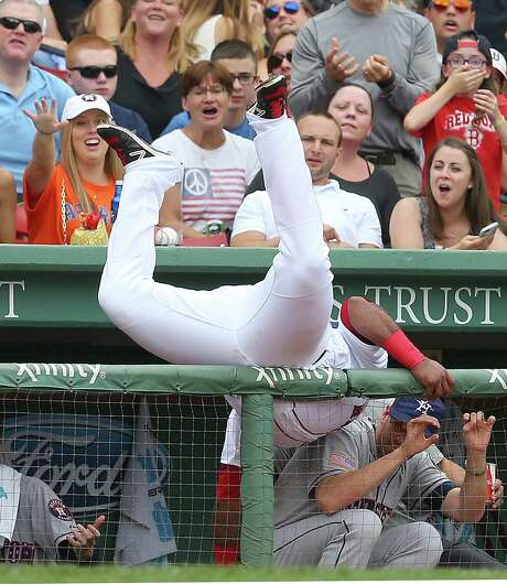 Although not known for his agility, Boston third baseman Pablo Sandoval gave it his all in getting to a fourth-inning foul ball during Saturday's win for the Red Sox over the Astros at Fenway Park. Photo: Jim Rogash, Stringer / 2015 Getty Images