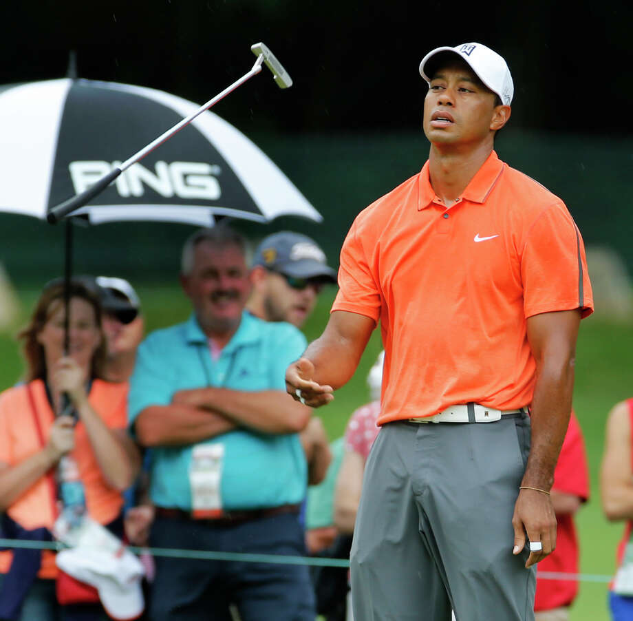 Tiger Woods wasn't in the best of moods Saturday after shooting a 71 to fall seven shots off the lead at The Greenbrier Classic. Photo: Steve Helber, STF / AP