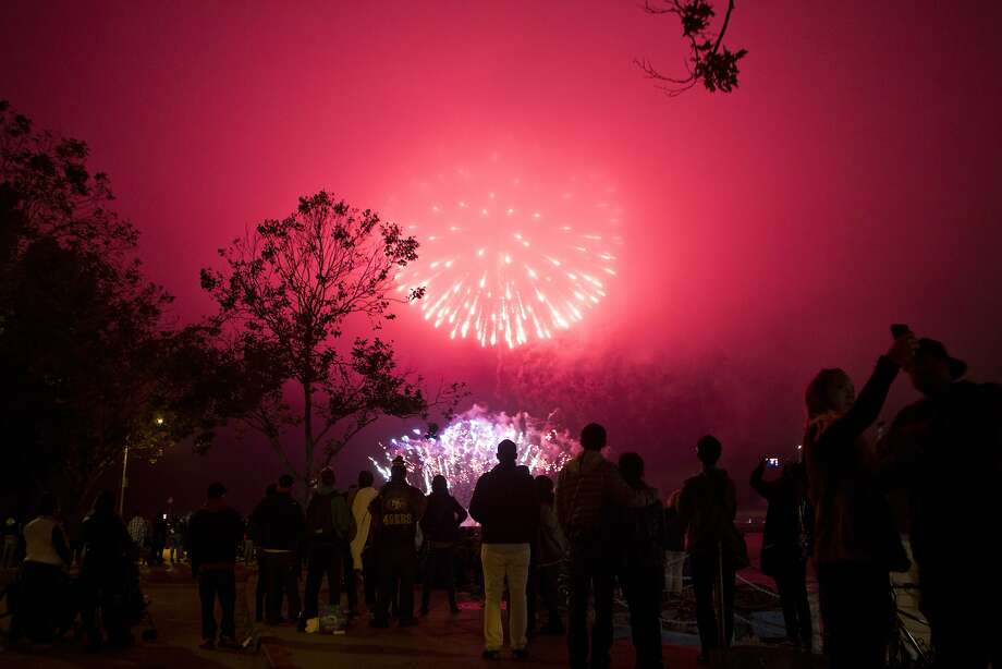 Fireworks are displayed over Aquatic Park Beach in San Francisco, Ca., as a part of the Fourth of July celebrations in this file photo from July 4, 2015. Clouds are expected right before this year's fireworks display. Photo: Dorothy Edwards, The Chronicle