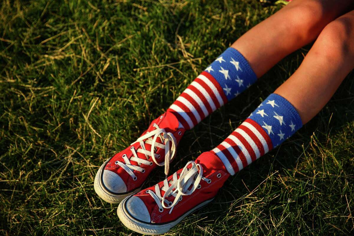 A woman sports appropriate socks and shoes during the Seafair Summer Fourth celebration at Gas Works Park on Saturday, July 4, 2015. Tens of thousands came out for the annual firework show on Lake Union.