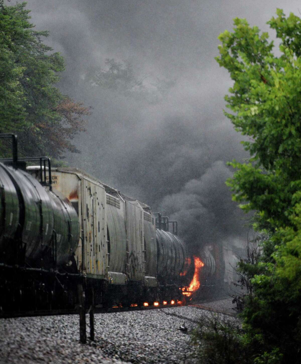 Smoke rises from a CSX train following the derailment of a train car, Thursday, July 2, 2015, in Maryville, Tenn. The derailment of the car, carrying a flammable and toxic substance, caused the evacuation of thousands in the surrounding area. (Michael Patrick/Knoxville News Sentinel via AP)