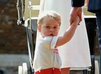 Prince George of Cambridge arrives for his sister Charlotte's Christening at St. Mary Magdalene Church in Sandringham, England, on July 5, 2015. Britain's baby Princess Charlotte was christened on Sunday in her second public outing since her birth nine weeks ago to proud parents Prince William and his wife Kate. The low-key ceremony took place in a church on the country estate of great grandmother Queen Elizabeth II. AFP PHOTO / POOL / CHRIS JACKSONChris Jackson/AFP/Getty Images