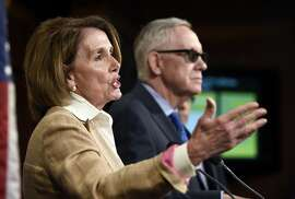 FILE - In this June 25, 2015, file photo, House Minority Leader Nancy Pelosi of Calif., left, accompanied by Senate Minority Leader Harry Reid of Nev. speaks during a news conference on Capitol Hill in Washington. Members of Congress return from July 4 fireworks and parades on July 7, facing a daunting summer workload and a looming deadline to fund the government or risk a shutdown in the fall. The government funding fight is shaping up as a major partisan brawl against the backdrop of an intensifying campaign season, with Republicans eager to avoid another Capitol Hill mess as they struggle to hang onto control of Congress and take back the White House next year.  (AP Photo/Susan Walsh, File)