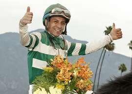 In a photo provided by Benoit Photo, jockey Victor Espinoza celebrates after Hard Aces won the Grade I, $500,000 Gold Cup horse race Saturday, June 27, 2015, at Santa Anita in Arcadia, Calif. (Benoit Photo via AP)